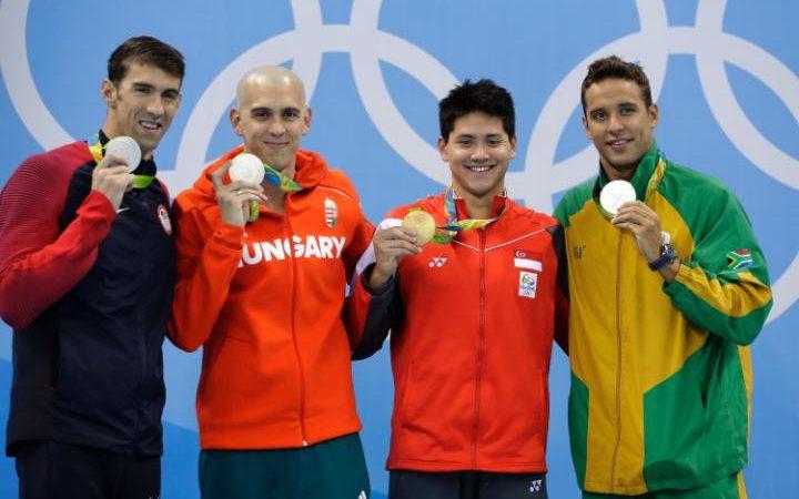 105635135-Phelps-medals-OLYMPICS-large_trans++LrSseiYmS3q0g1a2ZonCzQDfX_nBz_AbjSvXU4zRsH8